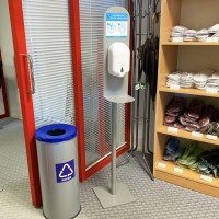 Hand disinfection station with dispenser